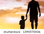 silhouette of father walking... | Shutterstock . vector #1390570436