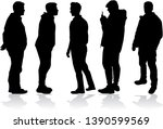 silhouettes of a man. vector... | Shutterstock .eps vector #1390599569