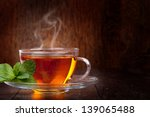 Stock photo cup of tea and mint on a wooden background 139065488
