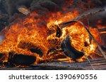 burning automobile tires ... | Shutterstock . vector #1390690556