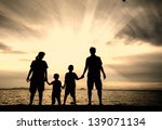 silhouette of happy family at...