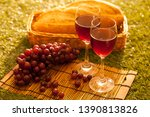 two glasses and  wine in summer | Shutterstock . vector #1390813826