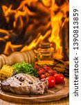 beef steak on the grill with... | Shutterstock . vector #1390813859
