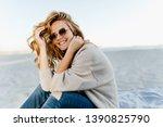 debonair blonde girl sitting at ... | Shutterstock . vector #1390825790
