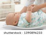 doctor weighting baby on scales ... | Shutterstock . vector #1390896233