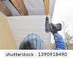 roofer contractor installing on ... | Shutterstock . vector #1390918490
