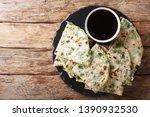 vegan scallion pancakes are a... | Shutterstock . vector #1390932530