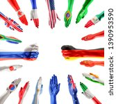 hands colored in flags of... | Shutterstock . vector #1390953590