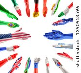 hands colored in flags of... | Shutterstock . vector #1390953596