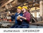 two restful technicians with... | Shutterstock . vector #1391004239
