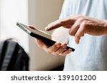 man uses a digital tablet | Shutterstock . vector #139101200