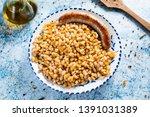 botifarra amb mongetes  fried... | Shutterstock . vector #1391031389