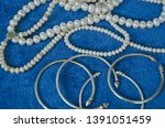 top view of pearl necklaces and ... | Shutterstock . vector #1391051459