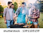 young people grilling and...   Shutterstock . vector #1391105159