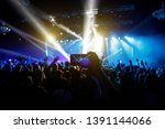 Stock photo photo for social networks at the concert mobile phone on music show 1391144066