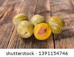 green plum  mirabelle on wood... | Shutterstock . vector #1391154746