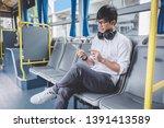 young asian man traveler... | Shutterstock . vector #1391413589