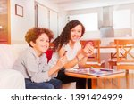 happy teens playing card games... | Shutterstock . vector #1391424929
