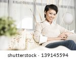 pretty chinese woman relaxing... | Shutterstock . vector #139145594