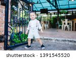 funny 2 years old little asian...   Shutterstock . vector #1391545520