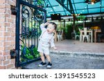 funny 2 years old little asian...   Shutterstock . vector #1391545523