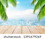 wooden table top on blue sea... | Shutterstock . vector #1391679269