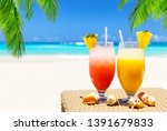 two tropical fresh juices on... | Shutterstock . vector #1391679833