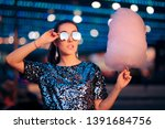 woman holding cotton candy... | Shutterstock . vector #1391684756