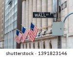"wall street ""wall st"" sign over ... | Shutterstock . vector #1391823146"