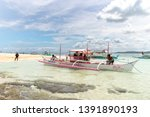 apr 27  2019 boat waiting for... | Shutterstock . vector #1391890193