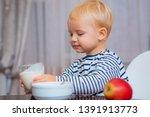 boy cute baby eating breakfast. ... | Shutterstock . vector #1391913773