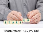 Small photo of Businessman complete his startup business. Investor accelerate start-up project concept.