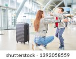 son welcomes his mother in the...   Shutterstock . vector #1392058559