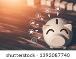 piggy bank coins with saving... | Shutterstock . vector #1392087740
