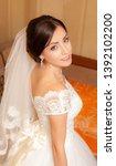 beautiful bride in white... | Shutterstock . vector #1392102200