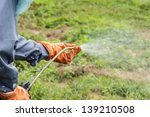 a man  is spraying herbicide in ...   Shutterstock . vector #139210508