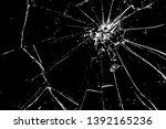 cracks in the glass on a black...   Shutterstock .eps vector #1392165236