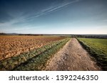 a long and stony path to the... | Shutterstock . vector #1392246350