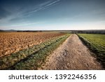 a long and stony path to the... | Shutterstock . vector #1392246356