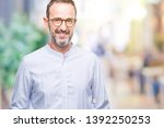 middle age hoary senior man... | Shutterstock . vector #1392250253