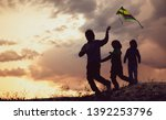 children playing with kite on... | Shutterstock . vector #1392253796