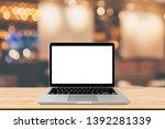 blank screen laptop computer on ... | Shutterstock . vector #1392281339