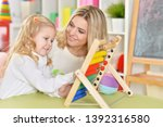 portrait of mother with little... | Shutterstock . vector #1392316580