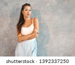 young beautiful woman looking... | Shutterstock . vector #1392337250