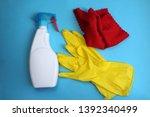 window cleaner gloves and rag... | Shutterstock . vector #1392340499