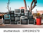 pile of old televisions... | Shutterstock . vector #1392342173