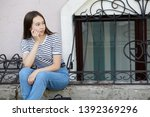 portrait of a stylish young... | Shutterstock . vector #1392369296