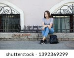 stylish young woman with... | Shutterstock . vector #1392369299