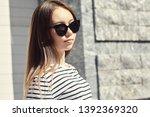 outdoor urban portrait of a... | Shutterstock . vector #1392369320