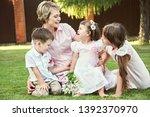 portrait of a happy family... | Shutterstock . vector #1392370970